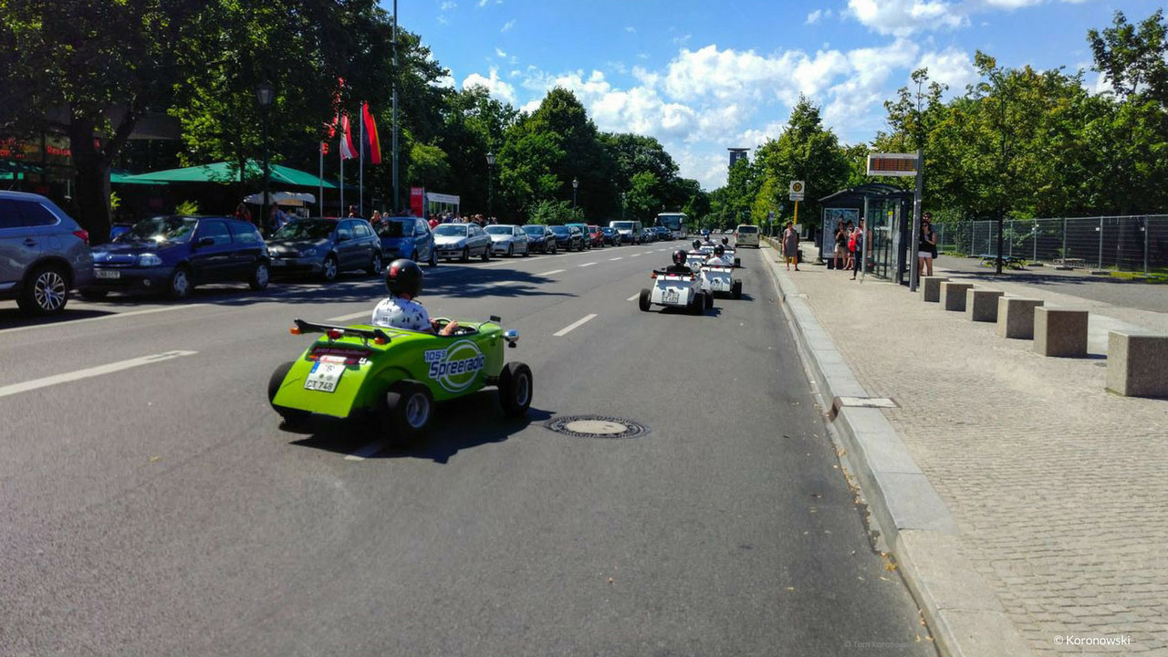 A convoy of mini hot rods on a city tour through Berlin.
