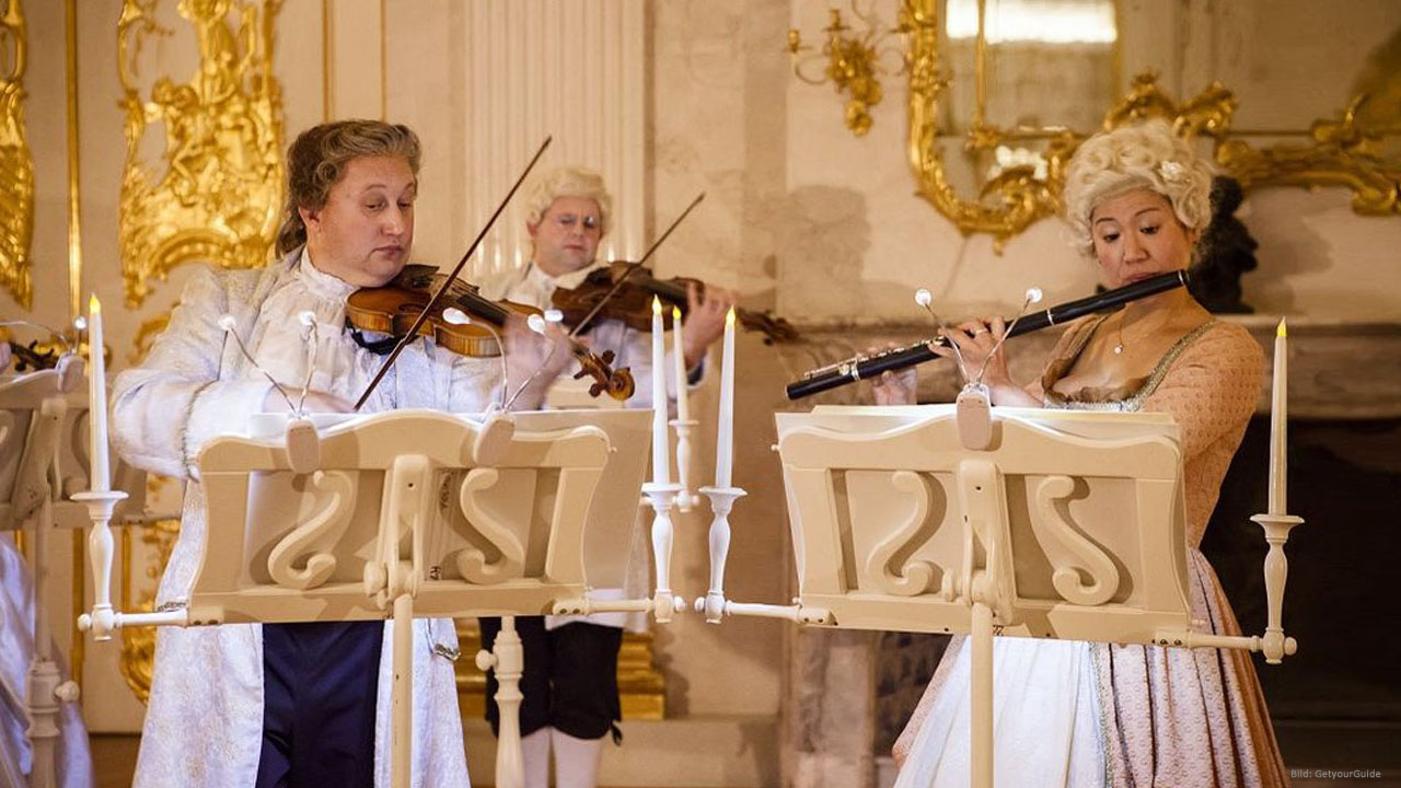 Solists in baroque clothing at a residence concert in Charlottenburg Palace Berlin